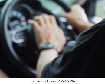 Abstract blurred background, Man is honking car.
