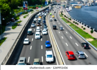 Abstract and blurred background of many cars in street