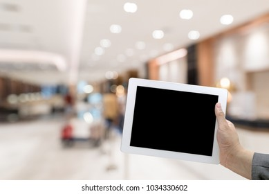 Abstract Blurred background of modern hotel lobby with digital Tablet