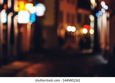 abstract blurred background of an old town street at night