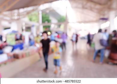 Abstract blurred background of people shopping at market.