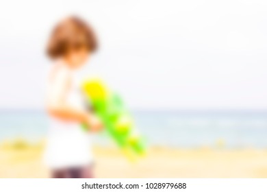 Abstract blurred background. Vacation and fun on the beach. Blurred people