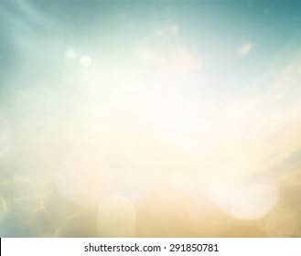 Abstract blurred beautiful beach with bokeh sun light sky texture background