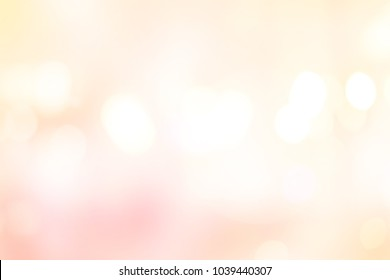 abstract blurred beautiful glowing pastel color of pink and yellow gradient background with double exposure bokeh light concept for wedding card design or presentation or other