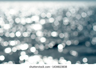 Abstract blurred beautiful glowing soft blue color with glitter bokeh light background for simple design concept