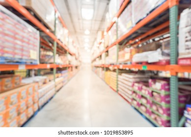 Abstract blurred big boxes wholesale store in America. Large warehouse with aisles and shelves of products from floor to ceiling.