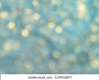 abstract blurred blue and gold bokeh background. glitter festive bokeh background.