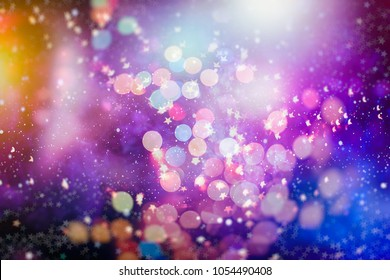 abstract blurred of blue and silver glittering shine bulbs lights background:blur of Christmas wallpaper decorations concept.xmas holiday festival backdrop:sparkle circle lit celebrations display