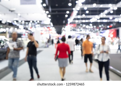 Abstract blurred bokeh of cars and people at Impact Muangthongthani in Nontaburi Thailand.