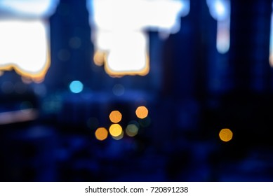 Abstract blurred bokeh city skyline background at twilight view