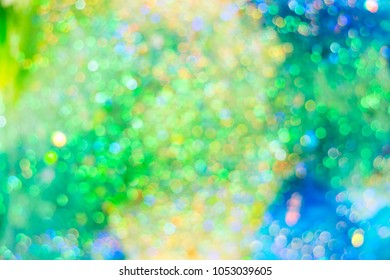 Abstract blurred bokeh composition from shiny holographic glitter.