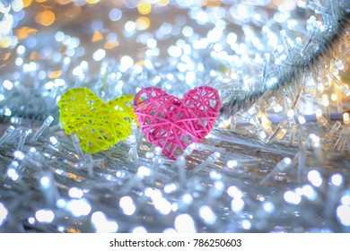 Abstract blurred bokeh and heart background for valentine love concept.Soft focus couple sweet heart sharp hand made with bamboo two color in circle bokeh led white background with copy space for text