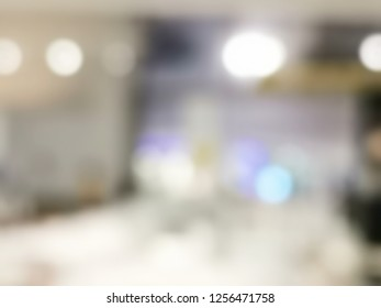 abstract blurred bokeh light in department store with color background concept
