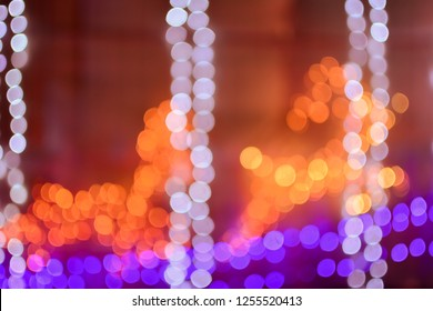 Abstract blurred bokeh lights background of christmas lights with Reindeer (Caribou) Iight shape. can used for Christmas Day concept.