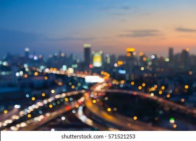Abstract blurred bokeh lights city and road intersection aerial view