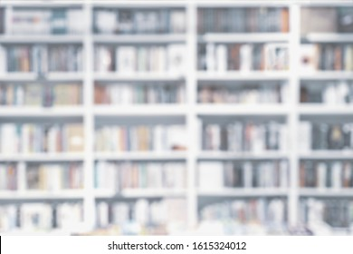 Abstract blurred bookshelves with books, manuals and textbooks on bookshelves in library or in book store, soft focus. Concept of learning, school, culture, education, for backdrop
