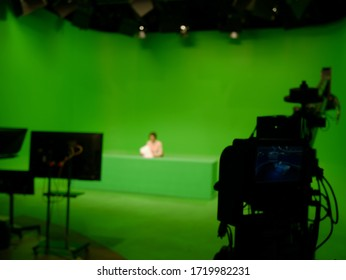 abstract blurred of broadcast camera in studio with virtual greenscreen at TV station.