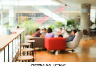 abstract blurred business man woman meeting collaborate in the cafe bar for business corporate concept.