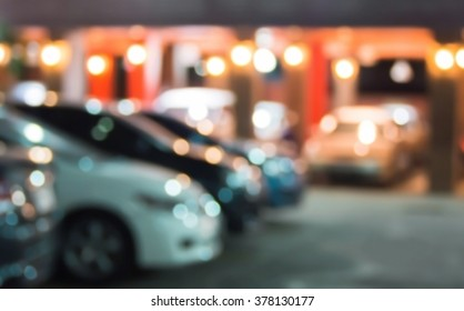 Abstract blurred car in hotel parking at night background.