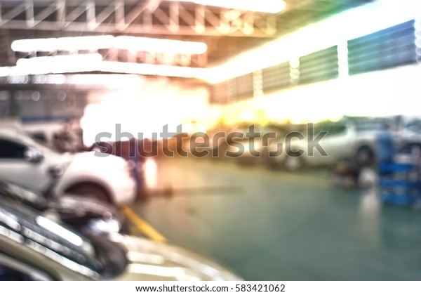 Abstract blurred car in parking background Built Structure, Flooring, Garage, Parking Lot, Basement
