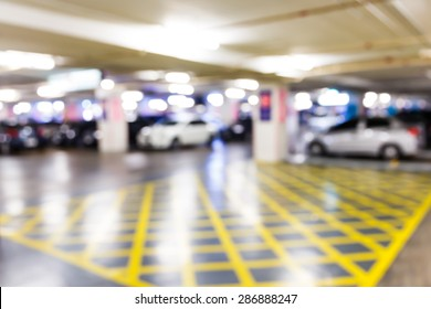 Abstract blurred car in parking lot of office building