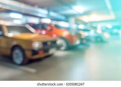Abstract blurred cars parking with bokeh light , Underground parking with cars. Background for use as Background