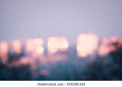 Abstract blurred city background in the morning. City sky with circular light with lens flare effect.