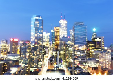Abstract blurred city night background with defocused bokeh lights