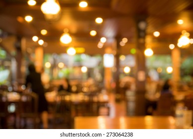 abstract blurred coffee shop with bokeh light, warm light tone