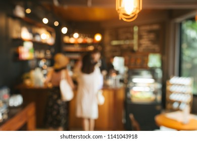 Abstract blurred coffee shop with people for background.
