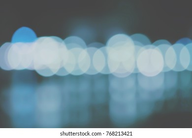 Abstract blurred of color glittering shine blubs lights background blur of Christmas wallpaper decorations concept. X-mas holding festival backdrop : sparkle circle light celebrations display.