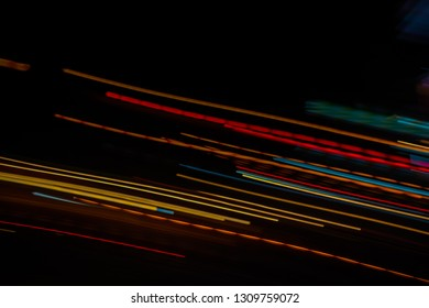 Abstract blurred colorful light effect on a black background. Long exposure photo of moving camera.