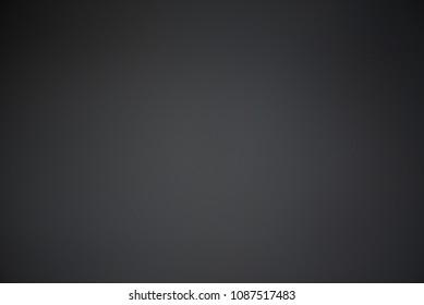 Abstract blurred dark background.