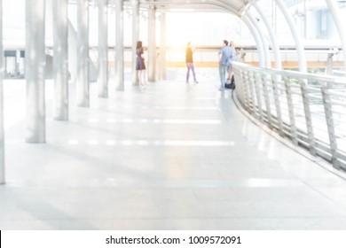 Abstract blurred defocus people standing in walkway corridor image background.