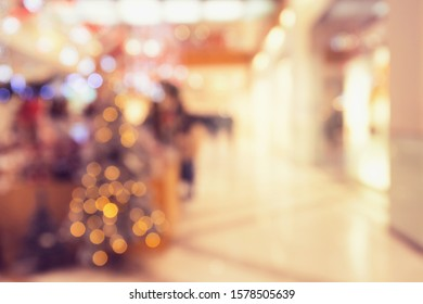 Abstract blurred and defocused background of shopping mall with bokeh. Christmas lights and garlands. Sales concept. Lifestyle theme