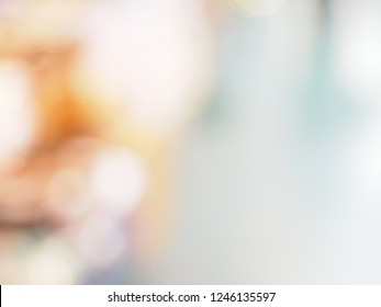 Abstract Blurred Defocused Bokeh Background Of Bright Colorful Light fade to white on the right corner