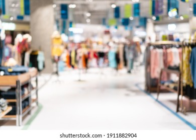 Abstract blurred or defocused of fashion clothes shop boutique interior in shopping mall.