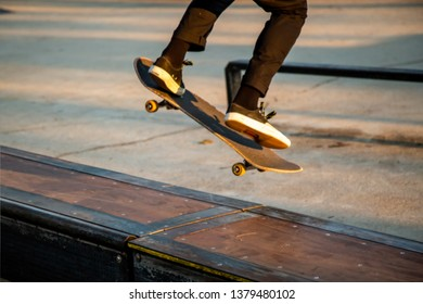 Abstract blurred / defocused of young teenager riding on a skateboard