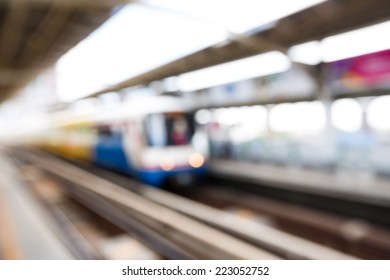 Abstract blurred electrical sky train at station