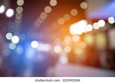 Abstract blurred of festival event with people and motor show background. Convention and Business event concept. People and lifestyle theme. Orange and Blue light tone. Defocused photo