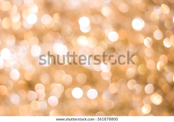 abstract blurred of gold warm tone and bronze glitter light background for Christmas decorations concept.