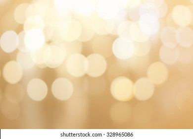 abstract blurred of golden gradient color background with circle light for design.