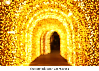 Abstract blurred of golden light tunnel for background.