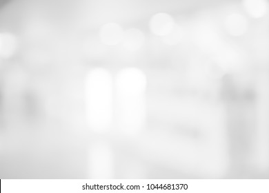 abstract blurred of gray silver background of modern contemporary interior office with bokeh light for presentation show design concept