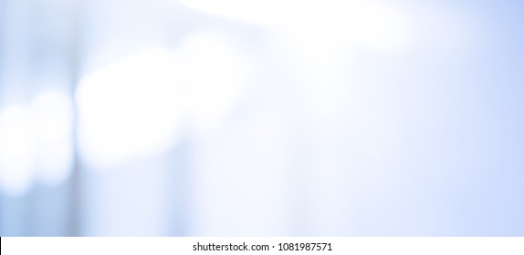 abstract blurred grey color cleaning office panoramic background with light effect for design as banner, presentation concept