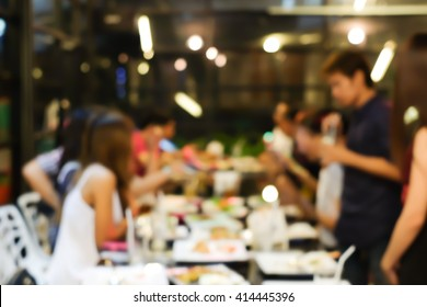 abstract blurred group of asian casual family meeting in the restaurant background at night.