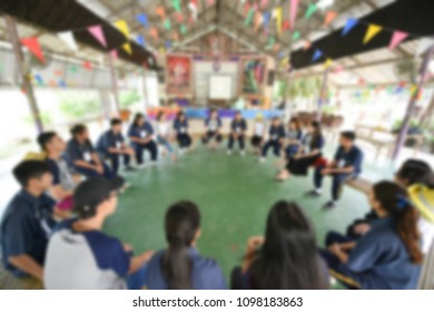 Abstract blurred : group of people sitting in a circle. concept of brain storming or team building. defocus