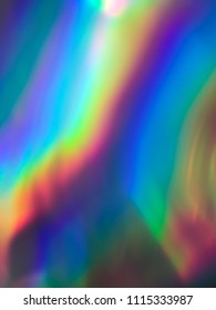 Abstract blurred holographic  background. Holographic iridescent gradient wrinkled foil. colorful vivid background.