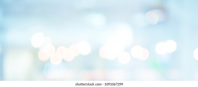 abstract blurred of hospital corridor blue color in panoramic background with double exposure of bokeh light concept.