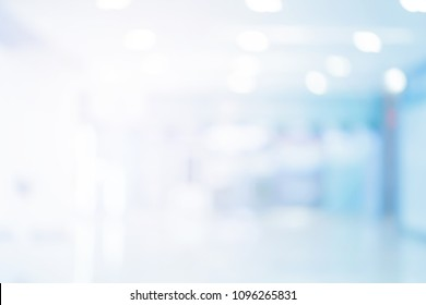 abstract blurred of hospital corridor blue color background concept.